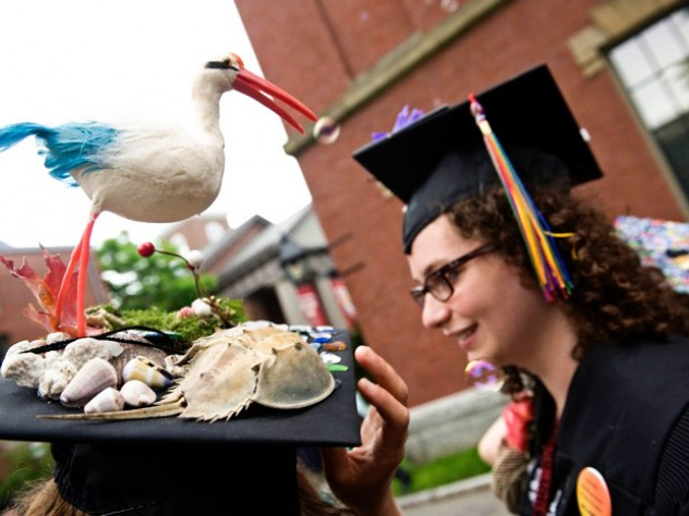 Martabel Wasserman, of Chepachet, Rhode Island, admiring the beach-ready mortarboard of fellow Dudley House Co-op resident Cora Currier, of The Plains, Virginia.