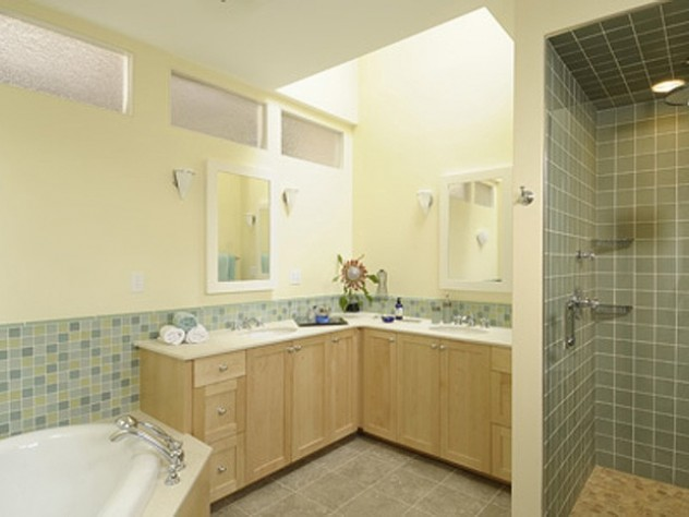 Another use of transom windows to bring light to a bathroom lacking exterior windows