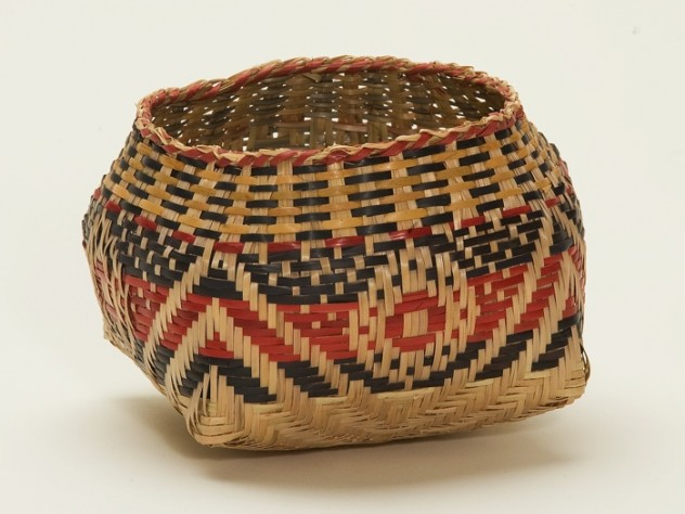 "A basket, signed ""Scarlett Darden 2002,"" by one of Clara Darden's descendants, displays an X with bull's-eye design pattern: ""Waxtik Kani."""