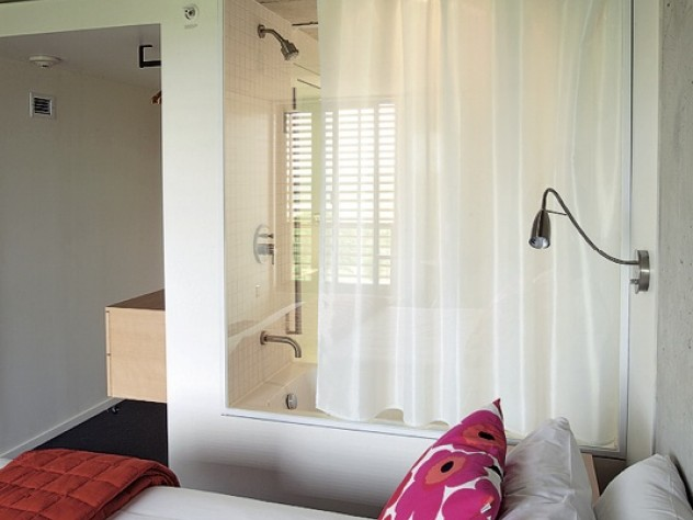 Glass wall separates bathroom from bedroom in new Kripalu dorm
