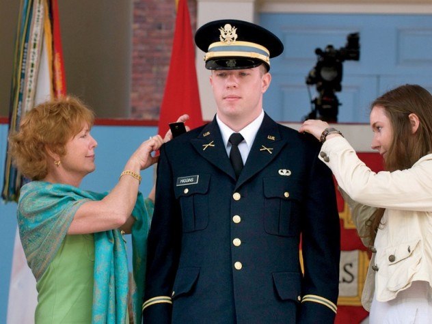 New second lieutenant Christopher Higgins '11 has his bars pinned on by his mother and sister.
