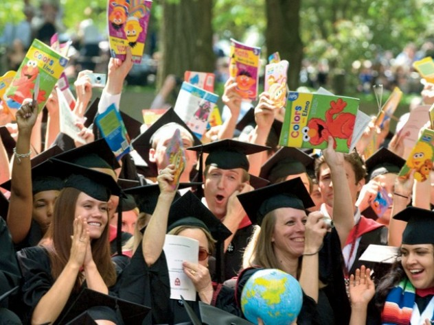 Still bullish on books: School of Education graduates celebrate their degrees. The picture books they carry are donated later; this year, half the books went to the Make-A-Wish Foundation, and half to the Reach Out and Read program at Children's Hospital Boston.