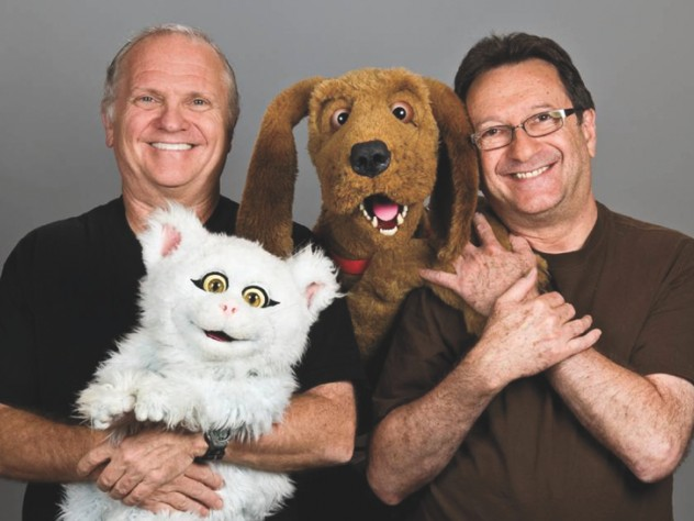 Cerf and colleague Norman Stiles flank dog star Lomax as Cerf holds Delta the cat.
