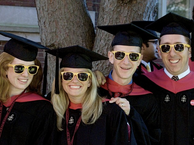 "Loyal to their M.B.A. cohort: Carolyn Daly, Stephanie Bartz, Robert Klaber, and Randy Shayler II showed up in matching ""HBS Section J 2012"" shades."