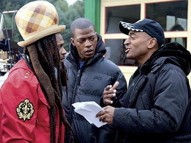 Khan advising Rastafarian musician David Hinds and Sanders