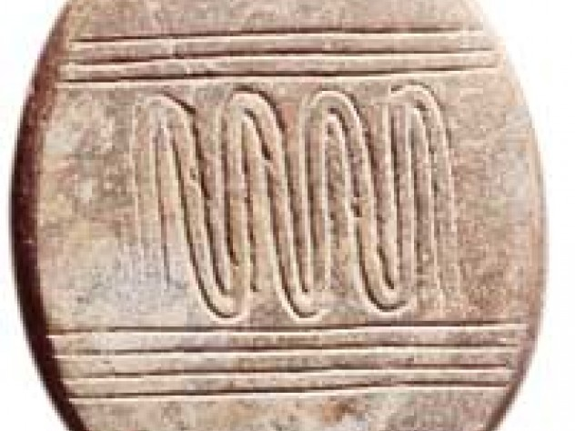This incised and polished pebble from Netiv Hagdud, 11,000 years old, displays a meandering pattern between parallel sets of horizontal lines that perhaps represents a river.
