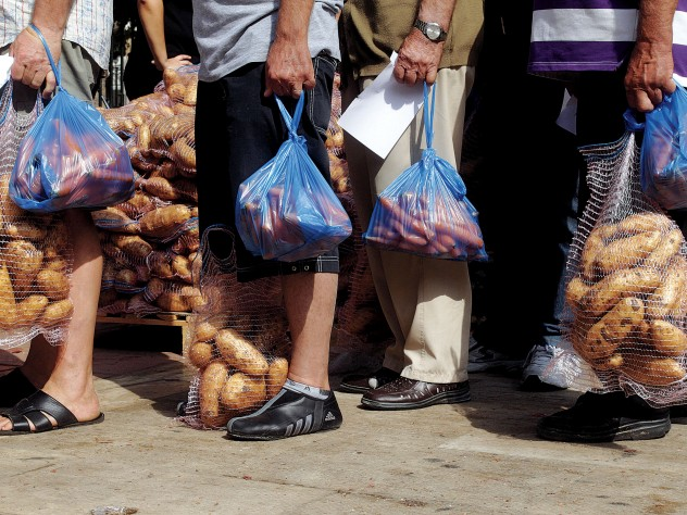 A nationalist political party distributes food in Athens, September 14, 2012.