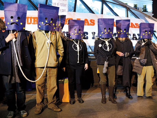 Madrid protesters against austerity wear nooses and bag their heads with a European Union flag motif, March 16, 2013.