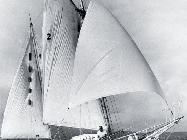 The 30-foot <em>Golden Rule</em> under sail, with James Peck '36 and Willoughby visible