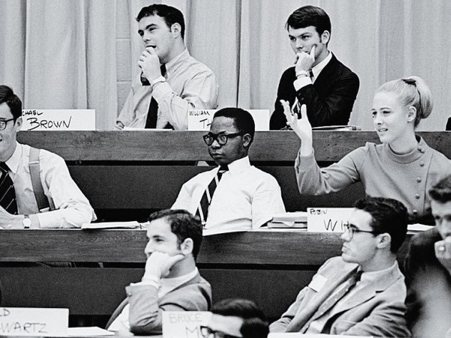 Harvard Business School pioneer Robin Wigger, suitably attired, in class among fellow M.B.A. students, circa 1970