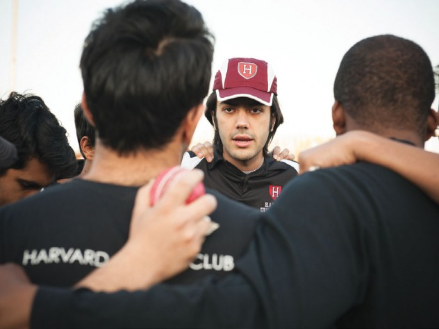 Ibrahim Khan '14 talks strategy with teammates before a game against Boston University in May.