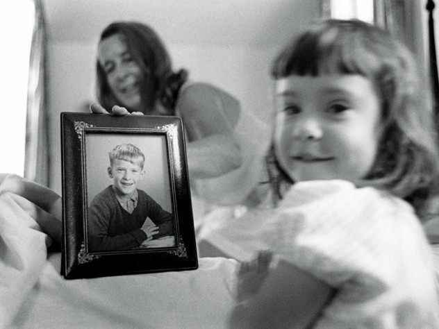 Eve, foreground, and her grandmother, with a fifth-grade photo of Geoffrey