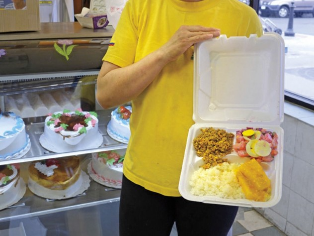 La Sultana Bakery sells cakes and pastries and has a savory breakfast and lunch buffet as well. Saleswoman Marleny Carmona proffers a plate of rice, stewed yuccas, shredded pork, and a beet salad with eggs, peas, and carrots.