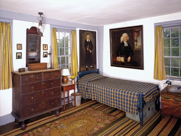 A child's room includes imposing family portraits and a nineteenth-century hooked rug with an unusual leopard design