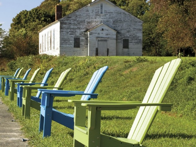 Visitors can take a seat after touring the historic Fort Andrews chapel.