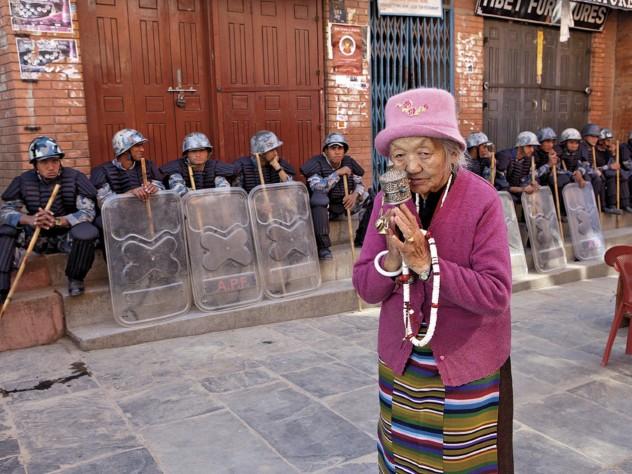 A Tibetan woman praying at the Boudhanath Stupa, near Kathmandu