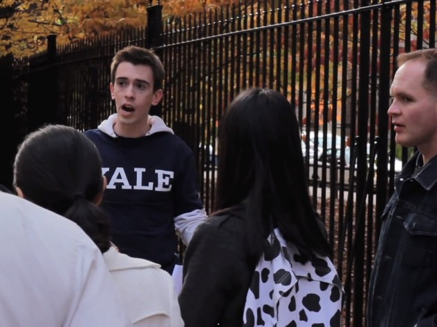 Samuel Clark, in costume, shows real tourists around Yale. He later said he was trying to be helpful.