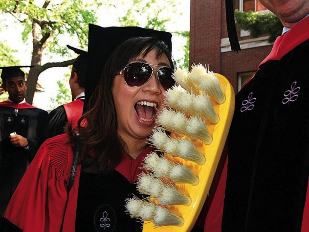 New doctor of medical sciences in oral biology (D.M.Sc.) degree-recipients Mindy Gil, D.M.D. '11, of Palos Verdes, California, and Peter Charles Grieco, of Garfield, New Jersey, reminding revelers about good dental hygiene