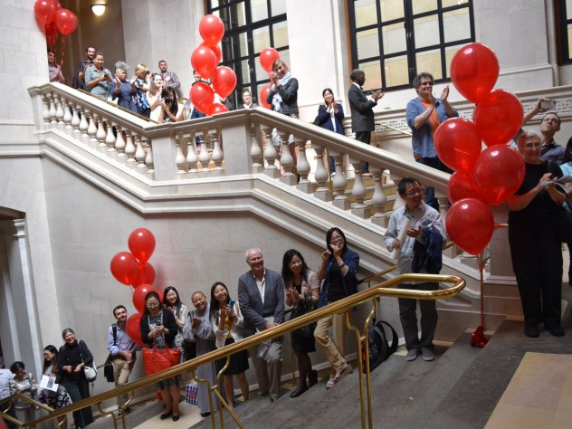 """Visitors who came to celebrate Widener's centennial sang """"Happy Birthday"""" in the library's main hall."""