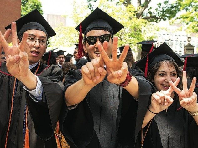 Class of 2015 First Marshal Sietse Goffard, of Bedford, Texas, with fellow class leaders Bob Wu of Sydney, Australia, Casey Fleeter, of Columbus, Ohio, and Christina Nguyen, of Irvine, California, XVing their Commencement pride