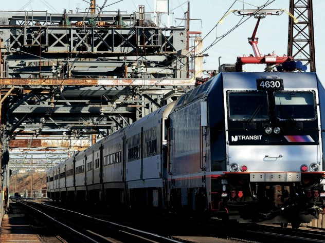 A New Jersey Transit train crosses a 1910 bridge in Kearney, N.J., over which 150,000 to 200,000 passengers cross daily—making it perhaps the busiest rail span in the Western Hemisphere. It is obsolete, but a $940-million plan to replace it remains unfunded.
