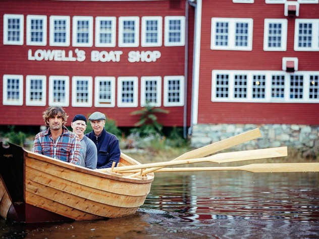 Graham McKay (front) with Jim Heller and Justin Kennick launching one of the shop's boats on the Merrimack River