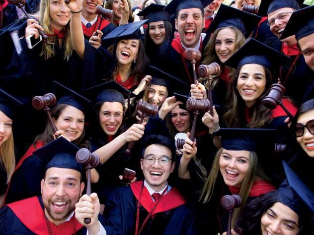 Law School graduates flaunt their profession's symbol of authority.
