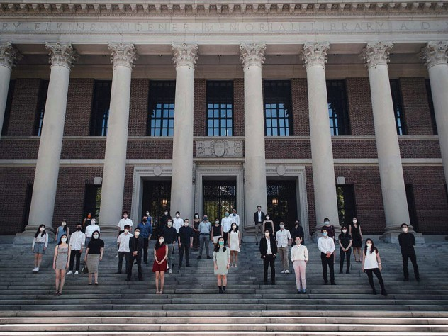 Group of degree candidates from the Design School pose on the steps of Widener for an unofficial Class Day photo.