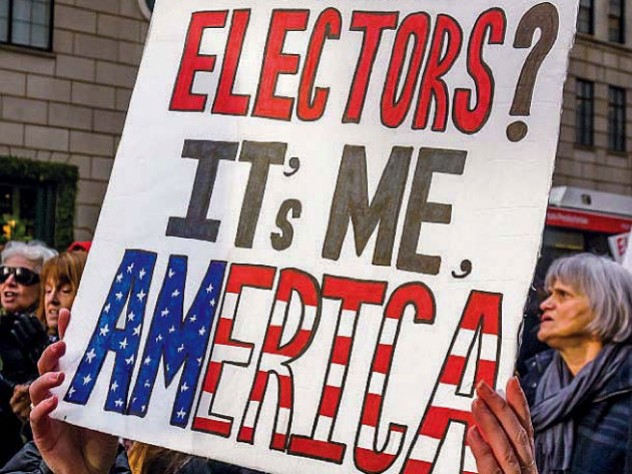 Protestors with a large poster demanding reform of the Electoral College