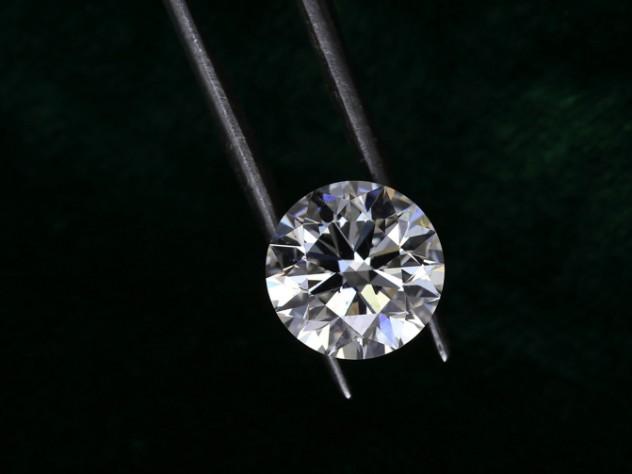 Diamond held by metal tongs