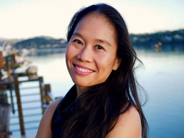 Photo of Bonnie Tsui standing on a pier