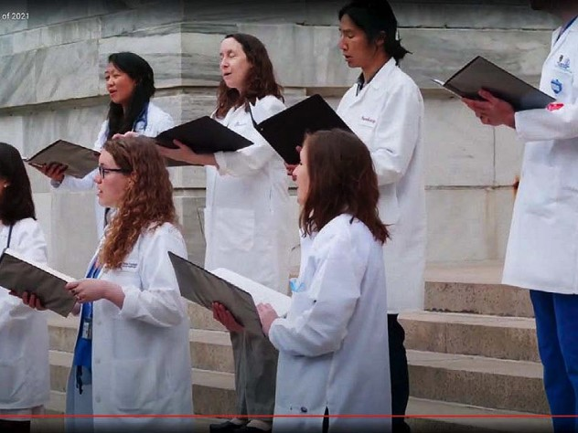 "Screen shot of medical chorus singing ""The Winter Is Past"" honoring pandemic first responders."