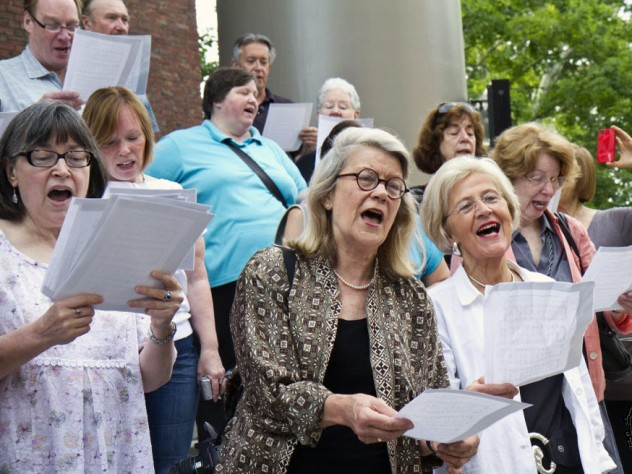 Church members, including (from left) Christine Whiteside, Professor Diana Eck, and Sedgwick associate minister in the Memorial Church Dorothy Austin, gathered on the church steps on June 20 to greet the first truckload of organ parts with a hymn.