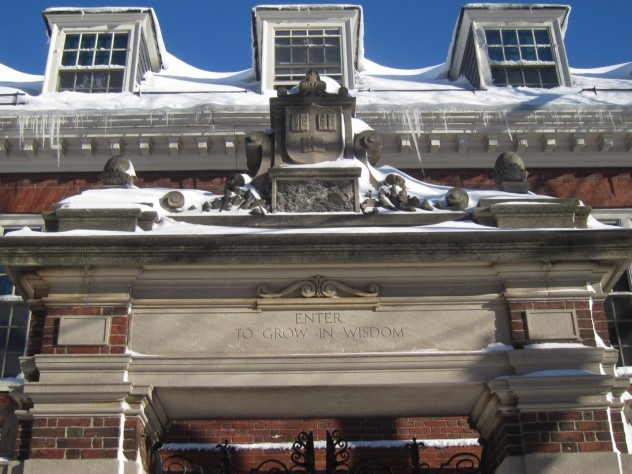 """Harvard's Dexter Gate, best known for its """"Enter To Grow in Wisdom"""" motto, is frosted with snow after the Blizzard of 2013."""