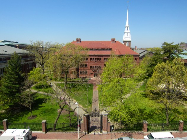 In Sever Quad, all paths converge on the Class of 1885 Gate. Sever Hall and Memorial Church  rise in the background. This view was taken from the roof of the Fogg Museum.