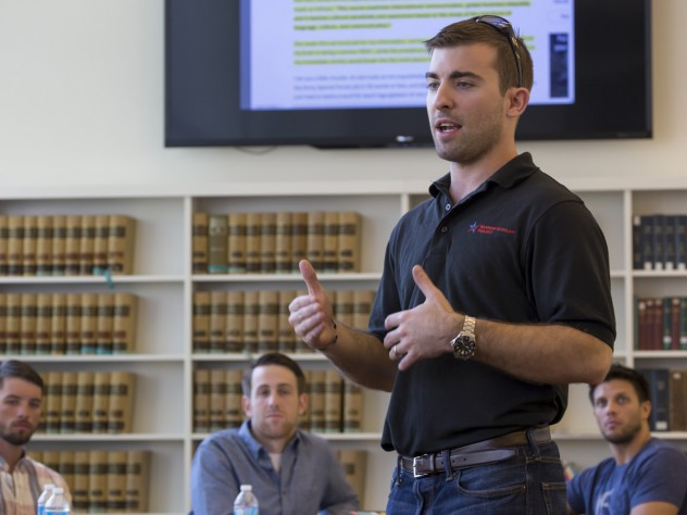 Program director Logan Leslie '16, a veteran of the Special Operations Forces and member of the National Guard, leads a seminar during the WSP course. The project, which debuted at Yale University in 2012, expanded to Harvard and the University of Michigan this year.