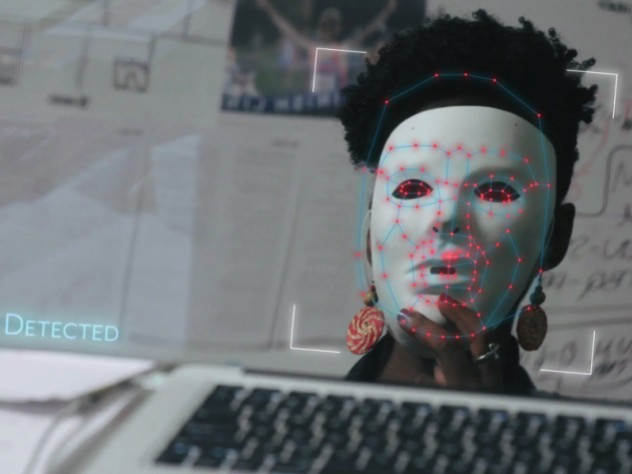Joy Buolamwini dons a white mask in order to be visible to facial recognition software in the film Coded Bias.