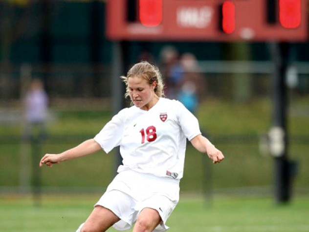 Soccer's Lizzy Nichols '10 uncorking one of her killer kicks. Though she's a defensive specialist who plays center back, Nichols has a knack for free kicks and penalty kicks, and ice water in her veins.