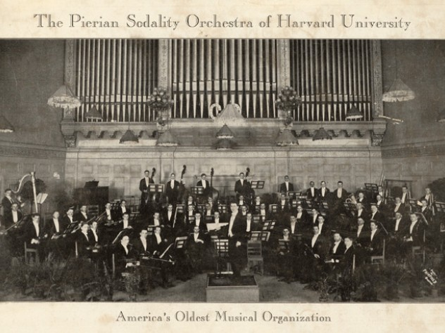 """This photograph, from a scrapbook collecting items from 1929 to 1950, depicts the """"Pierian Sodality Orchestra"""" at Boston's Symphony Hall."""