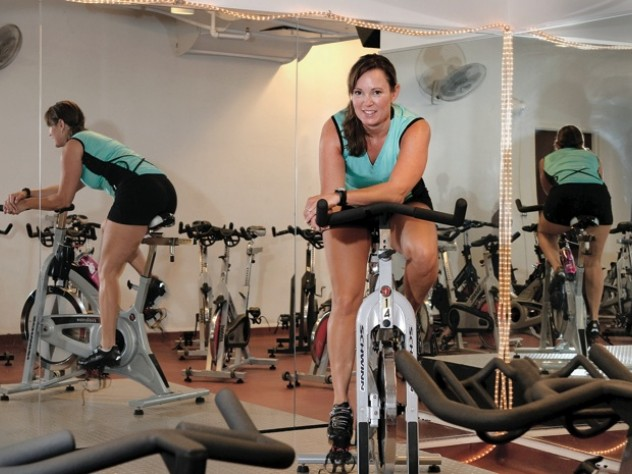 Murdock Stenis warms up for indoor cycling, an intense interval  workout with music.