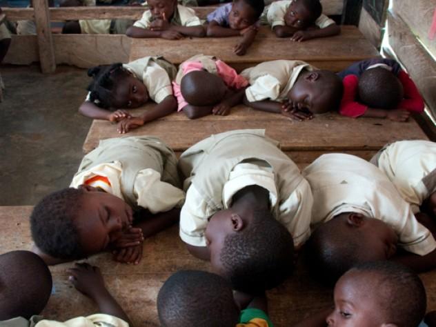 Children enjoy their naptime inside the kindergarten 1 and 2 classroom of Salomey Kortsu at Desmercy School.