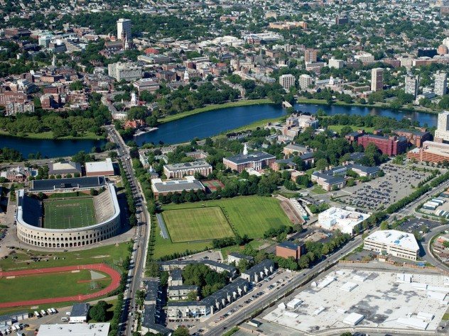 """The Harvard campus, looking northeast toward Cambridge from the intersection of Western Avenue and North Harvard Street in Allston, where the mothballed science center dominates the right foreground. William James Hall looms in the distance.  [<a href=""""http://harvardmagazine.com/sites/default/files/375_so11_003_web_0.jpg"""">VIEW LARGER PHOTOGRAPH</a>]"""