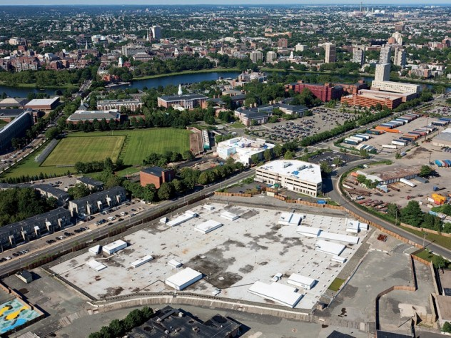 """From a vantage point south of Western Avenue in Allston, looking northeast toward Harvard Square, the unfinished science complex dominates the foreground. Beyond it lie athletic fields that may yield to expansion by the School of Public Health, the Graduate School of Education, or other academic enterprises. A business """"enterprise research campus"""" is envisioned south of Western Avenue, across from the high-rise graduate-student housing at One Western Avenue."""