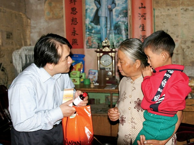When traveling, To carries large quantities of food and drugstore items that he offers to families in need.