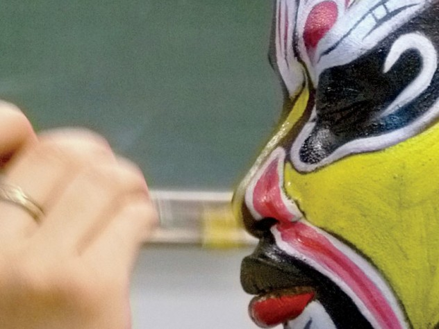 "Detail of ""Painting Faces of Beijing Opera,"" by Christine Shen '12, on display in lamont library"