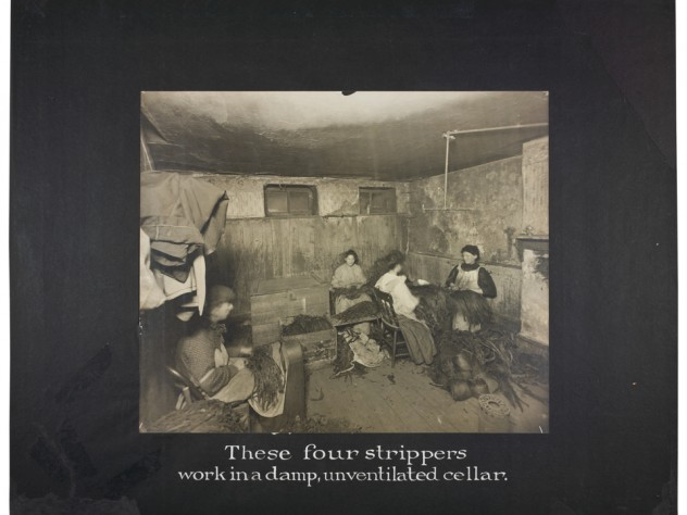 Lewis Wickes Hine, <i>Industrial Problems, Conditions: United States. Pennsylvania. Pittsburgh. Pittsburgh Survey: These Four Strippers Work in a Damp, Unventilated Cellar,</i> 1907–8. Gelatin silver print mounted to board, white gouache.