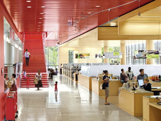 On the ground floor, patrons see books as soon as they enter.