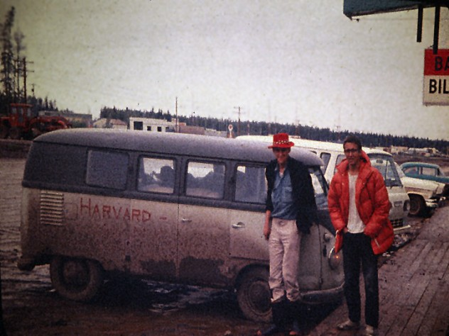 John Graham and David Roberts on the Alcan (Alaska-Canadian) Highway, en route to Mount McKinley, pose alongside the team's VW Microbus.