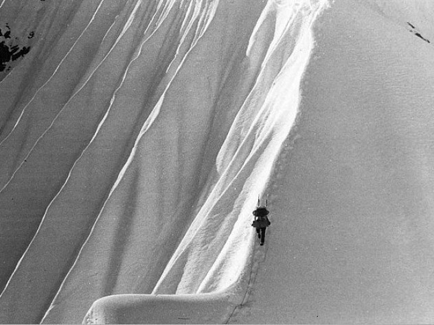 Above Camp Four, at about 8,800 feet, a Harvard climber ascends a fluted snow ridge.