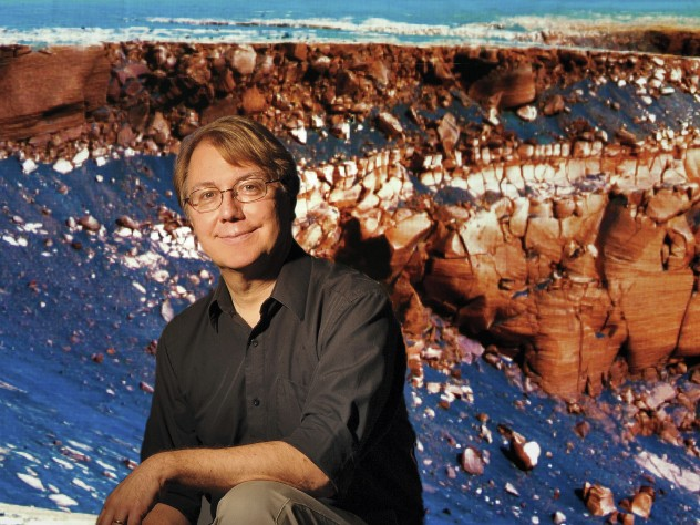 Fisher professor of natural history Andrew Knoll, curator of the Harvard University Herbaria's paleobotanical collections.  Behind him is an outcropping of ancient sedimentary Martian rock, which he's studied for NASA's Mars Exploration  Rover Mission.